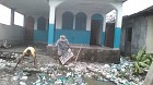 Parishioners clean up debris from the church property.