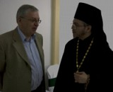 Fr. Nektariy talks with<br>Russian Embassador Valry Morozov.