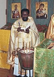 Fr. Christopher Walusimbi <br>serves Liturgy in Beltsville, MD.