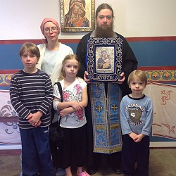 The Campbell family with the Hawaiian icon of the Theotokos.<br/>Ella is holding her IV bag