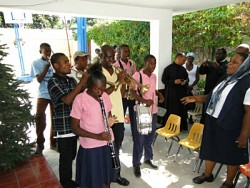 Students at the Foyer d'Amour school played in honor of the Metropolitan.