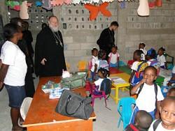 Metropolitan Hilarion visits a parish school in Port-au-Prince.at