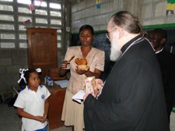 A school student greets Metropolitan Hilarion in Haiti.